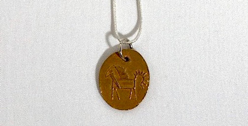Bronze Pendant with Hierogryphics Design