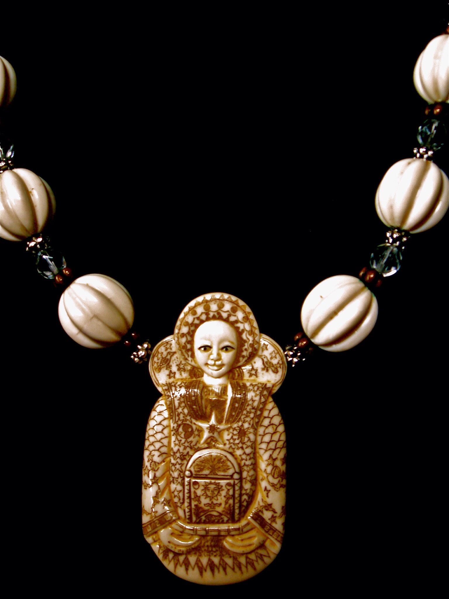 Carved bone Seer Pendent on a Vintage necklace of bone Crystal & Brass Beads