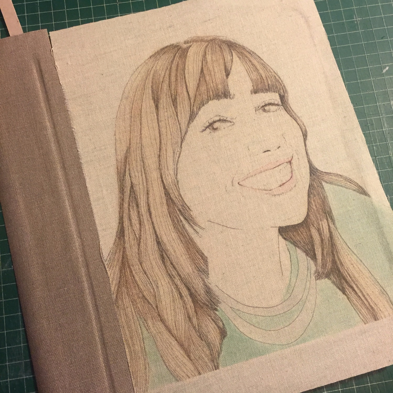 Cuaderno con retrato