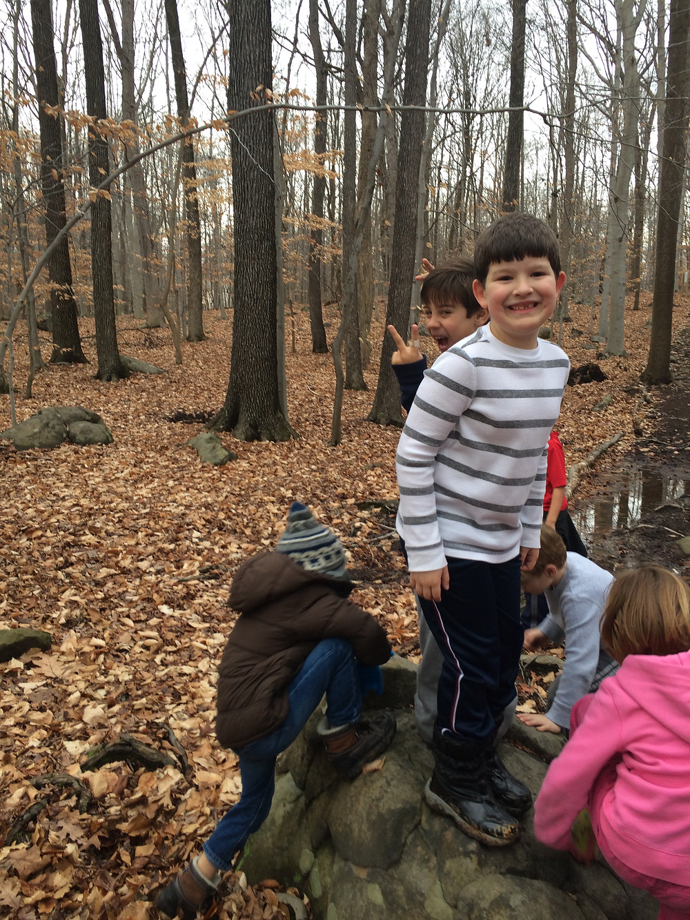 Students love climbing the rocks on the trail!