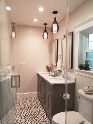 Cement tile, unique light fixtures and a double vanity add character to the new bathroom