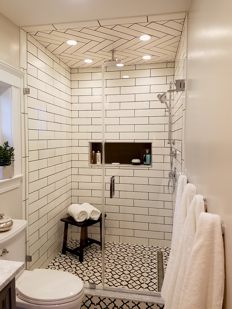 The project included adding a bathroom to the second floor master bedroom, along with new built-in closet cabinetry