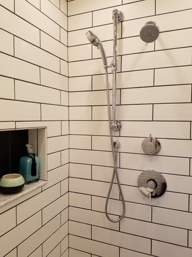 Large subway tile pays homage to the classic details found elsewhere in the home, while the 3 shower heads in the master bath add a spa like space