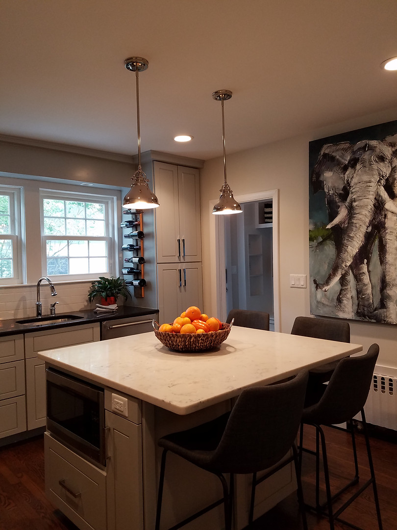 Downstairs the existing kitchen got an added dose of function with a custom built island