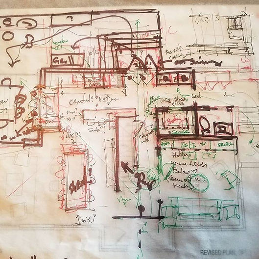 A hand sketch on trace paper of a kitchen design concept