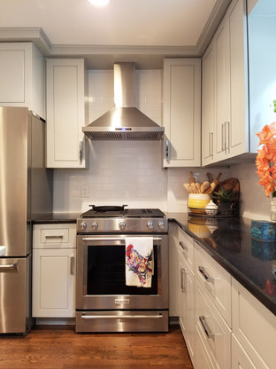 The entire kitchen got a face lift with new upper cabinet doors, hardware, appliances and paint throughout