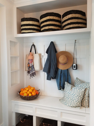 The dark side entry became a charming new mudroom with functional built-in cubbies and piano hinged seat.