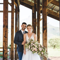 bride and groom with florals