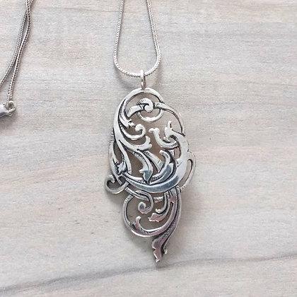 pierced sterling pendant