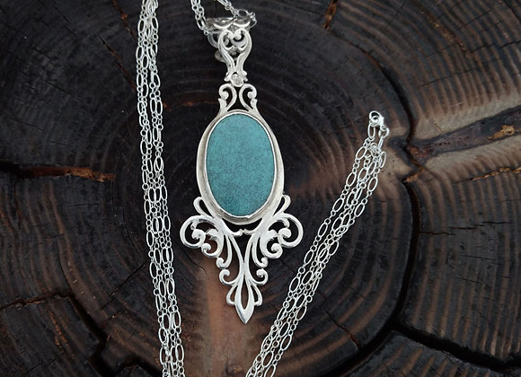 Peirced turquoise pendant.
