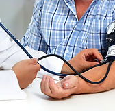 Doctor measuring blood pressure with sph