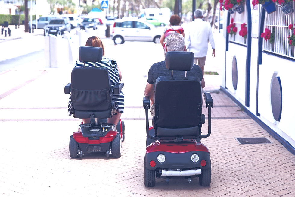 Couple%2520elderly%2520people%2520ride%2520along%2520the%2520sidewalk%2520to%2520an%2520electric%252
