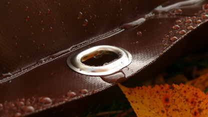 Metal eyelets on edges