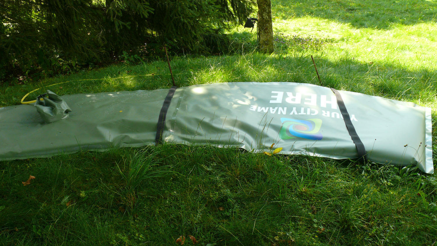 Placement of the TREEIB® irrigation bag on sloping grounds.