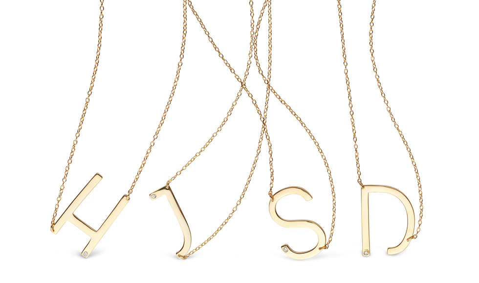 Gold and diamond initial necklaces by Anthony Dreyer