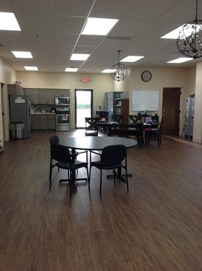 Spacious area with kitchen and lockers