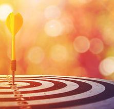 target dart with arrow over blurred boke