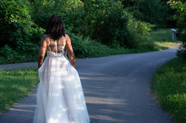 Beautiful bride walking down a road.jpg