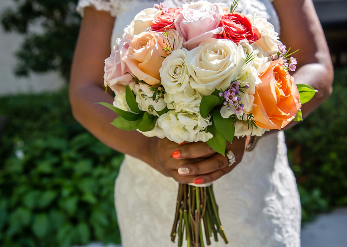Lady holding wedding flowers