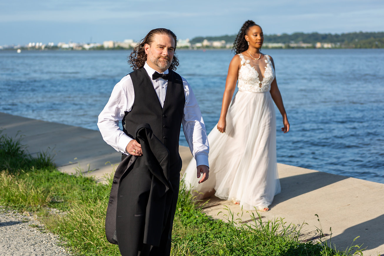 Candid image of Bride and groom walking.