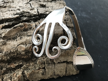 Bangle made from a heavy silver dinner fork