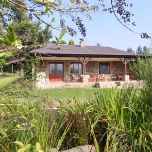 Veranda from pond - Watersmeet Cottage