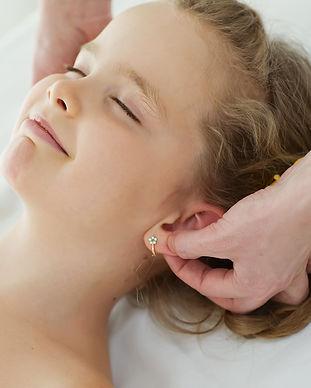 doctor massaging or doing gymnastics baby girl.jpg