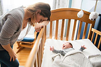 Tired Mother with Upset Baby Suffering with Post Natal Depression..jpg