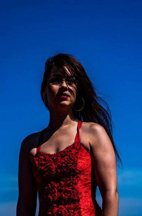 Zahira headshot red RTG dress.jpg