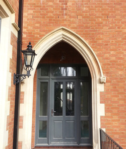Moulded door surround with carved stone corbels to finish