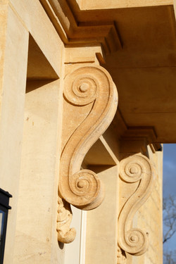 Natural stone scroll corbels
