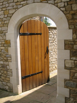 Stone arch surround with quoins