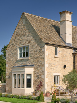 Stone bay window, heads and cills, quoins and chimney stack