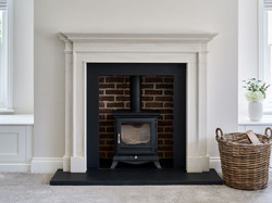 Stone fireplace with slate side slips and outer hearth