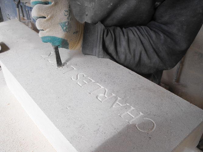Stonemason creating name plate 2.jpg