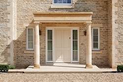 Stone portico with Grange Hill Grey and Cream mixed building stone, with bullnosed sawn stone paving
