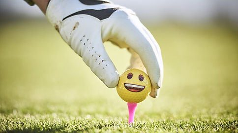 yellow-smiley-face-golf-ball-on-tee-960x