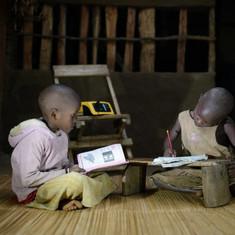 Children_studying_at_night_under_light_f