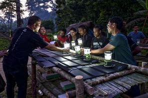 The Malaysian Insight: Orang Batek kampung lights up