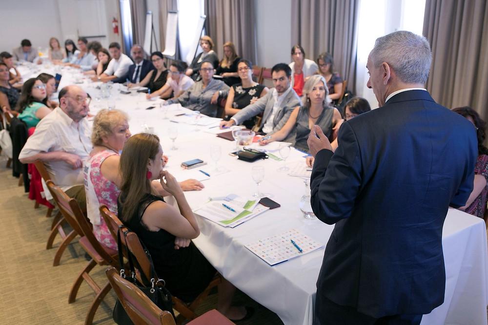 Photo of Dr Edgardo Buscaglia addressing the workshop participants.