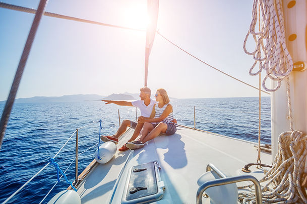 Young couple relaxing on the yacht cruis