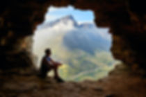 photo-of-man-sitting-on-a-cave-1659437 (