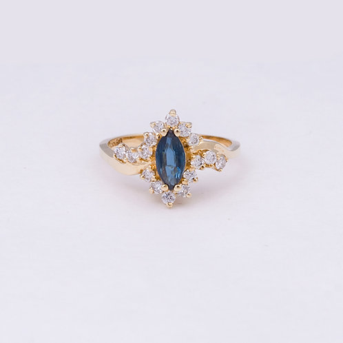 14k ring with Diamonds and a Sapphire