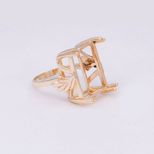 14k Ring holds a 12x8mm stone