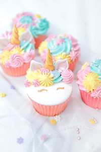 Unicorn fondant cupcakes frosting with b