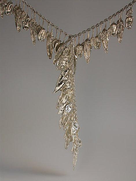Tres chiles: dos collares de plata