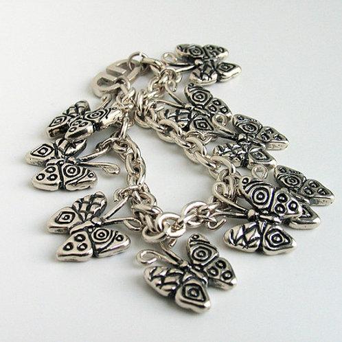 Pecas: pulsera de plata
