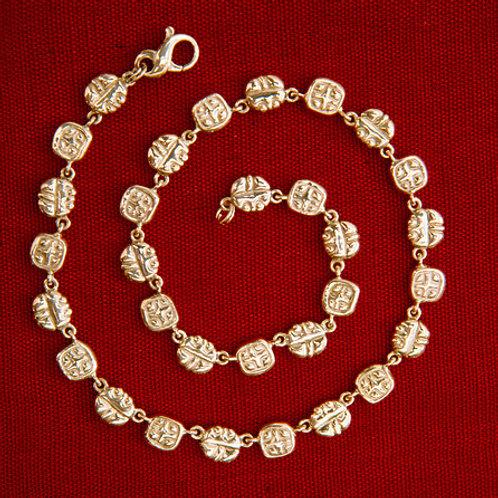 Sello de nobleza: collar de oro