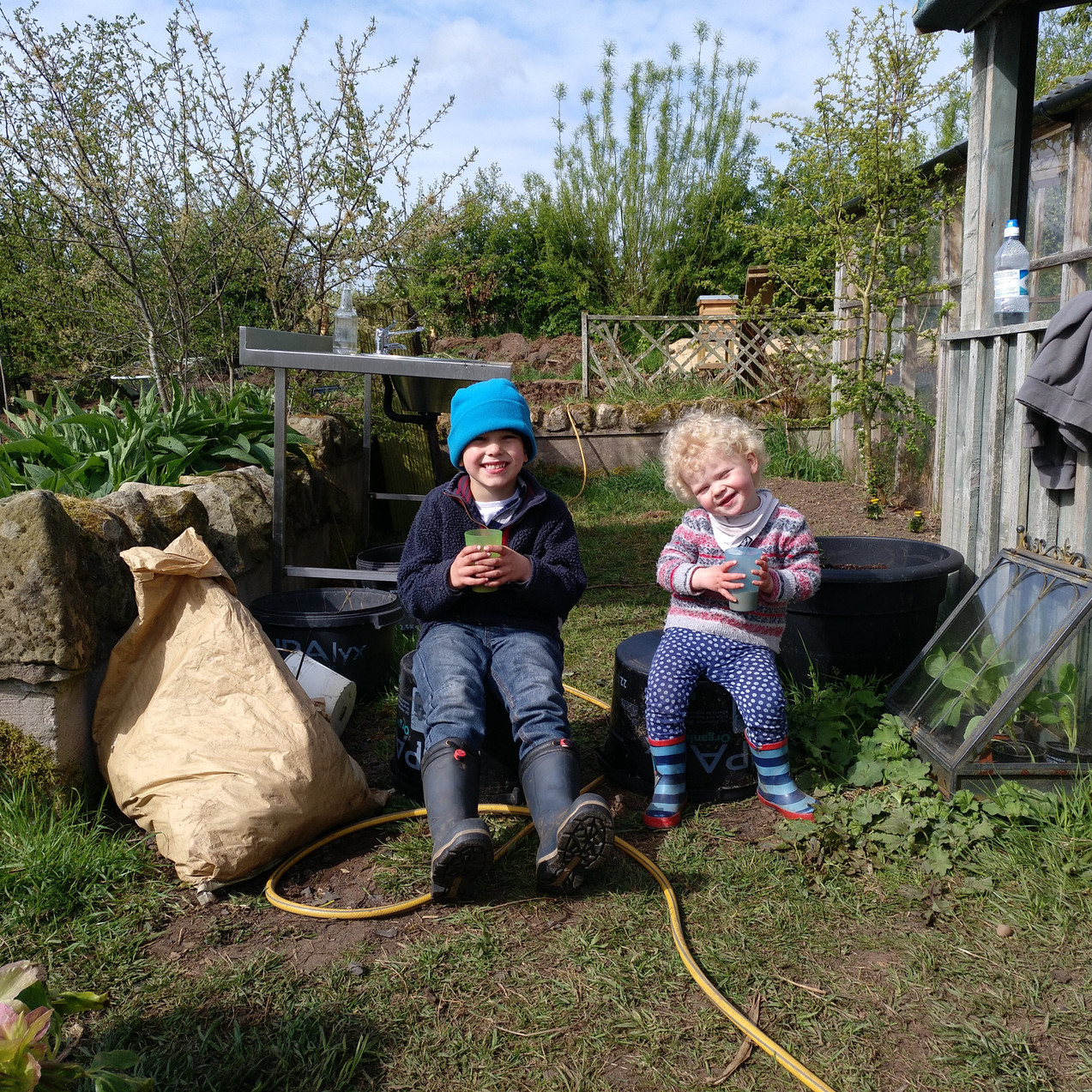 Two of the farm labourers enjoying morning hot chocolate