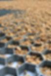 golden gravel in black 100% recycled 38-25 grid.JPG